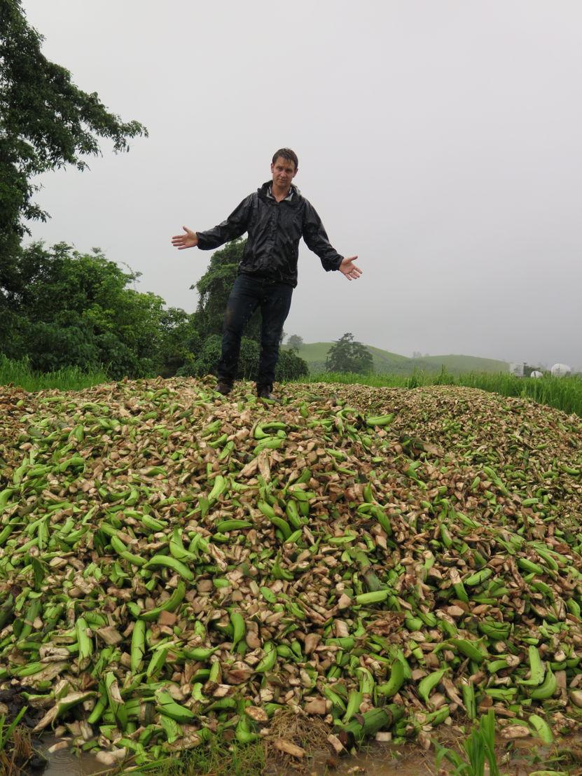 Craig Reucassel on top of banana waste