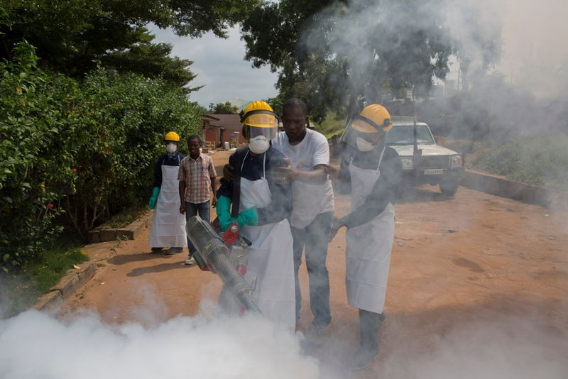 Medecins Sans Frontieres (MSF) staff members fumigate a neighbourhood in Matadi, during an operation to kill adult mosquitoes. Photographer: MSF