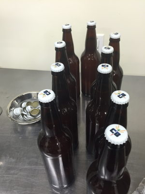 Capped bottles of cantaloupe gose will be conditioned for 2 weeks before they're ready to drink