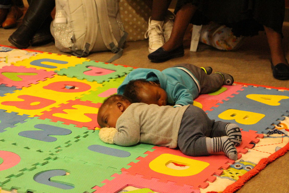 """Early childhood development activities include """"tummy time"""", and making mobiles and shakers. Photographer: Sean Christie"""