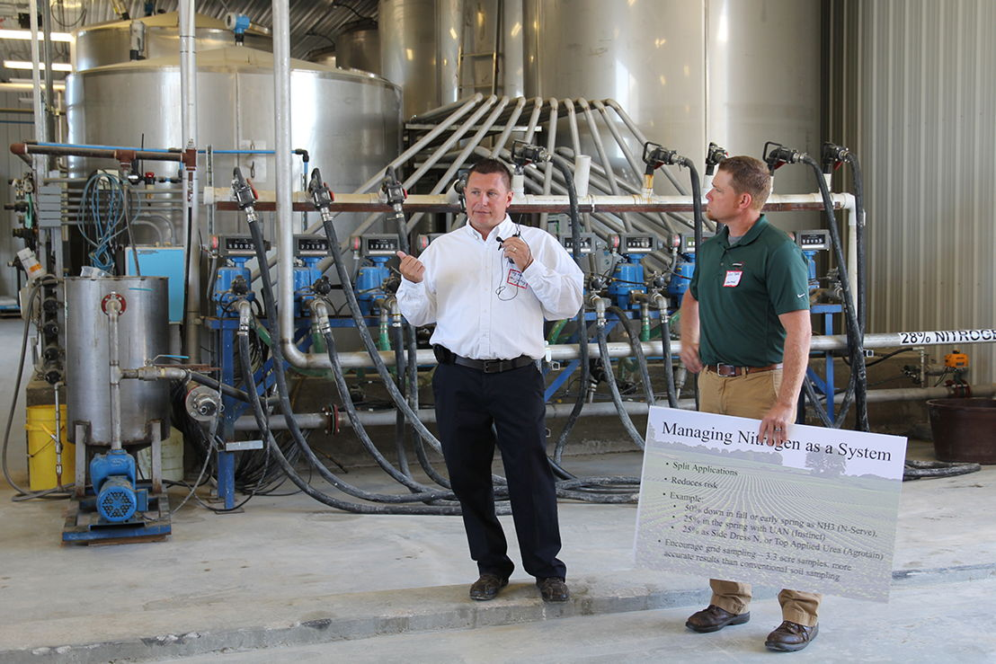 Troy Koehler, Agronomy Manager for New Century FS (left) and Nate Pierce, Agronomy Business Manager for GROWMARK  (right) talk about how the ag chemical handling system can customize chemicals for managing nitrogen.