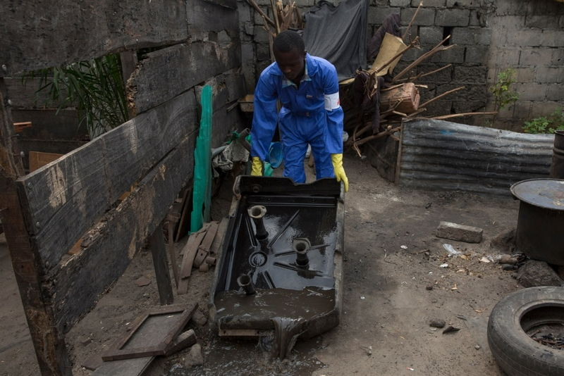 Medecins Sans Frontieres (MSF) staff member empties a water tank in Ndjili area in Kinshasa, during an operation to find and irradiate areas where mosquitoes breed. One case of yellow fever was detected in the neighborhood. Photographer: MSF