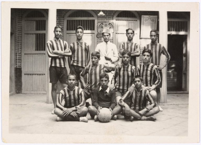 Portrait of the Iraqi Volleyball Team, in the background the coat of arms of the Iraqi royal family (1921-1958), unidentified photographer, Iraq, c1930. FAI Collection, courtesy of the Arab Image Foundation