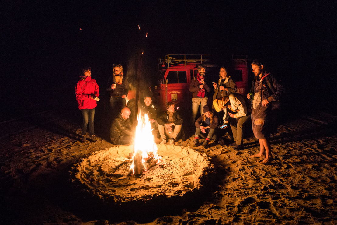 People enjoy bonfire on beach at night, Vlieland, West Frisian Islands, Friesland, Netherlands © Holger Leue for Merk Fryslan