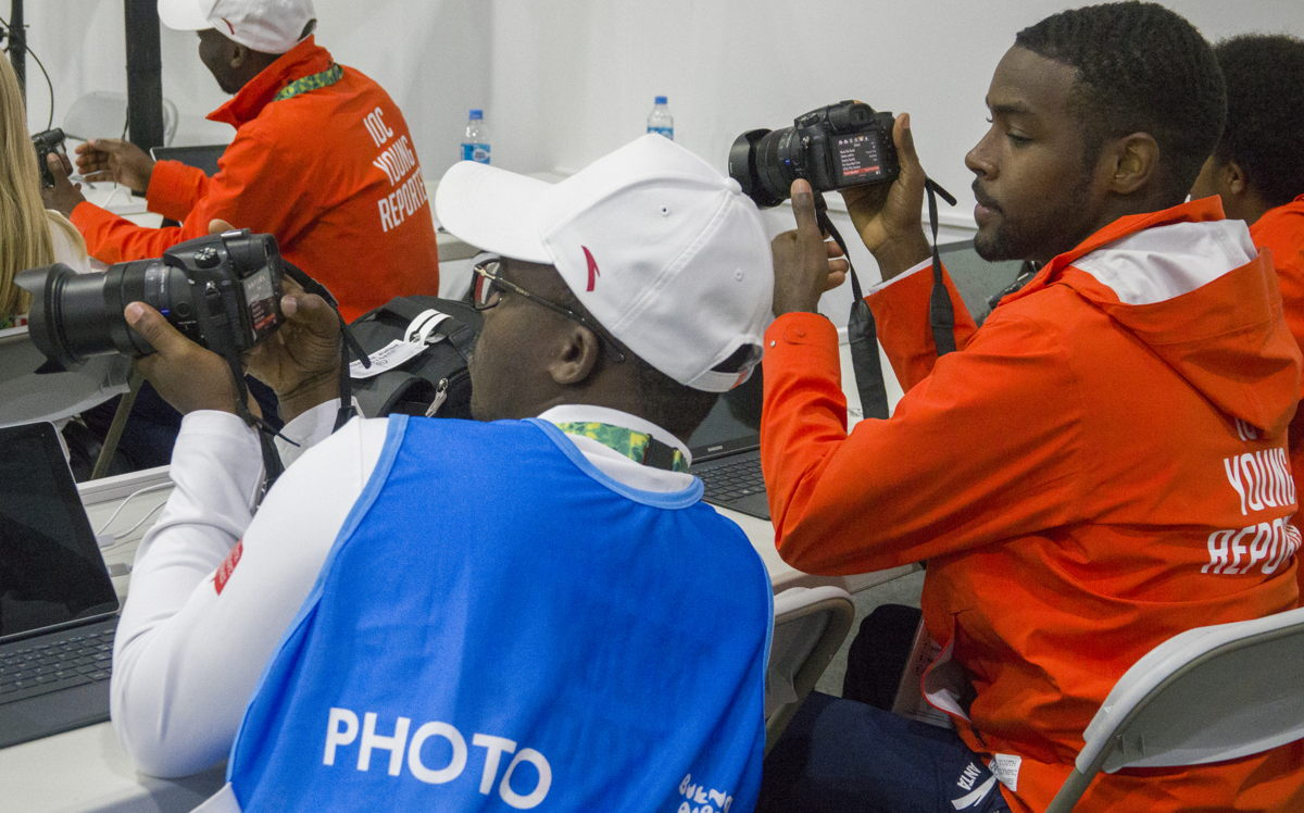 Sharome (right) engaged in photography class alongside fellow Young Reporter, Yao Bernard Adzorgenu of Togo