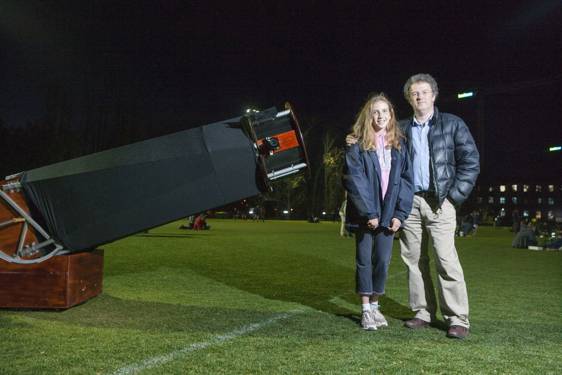 Anthony and Holly showing off their hugely impressive homemade telescope. Image: Lannon Harley, ANU