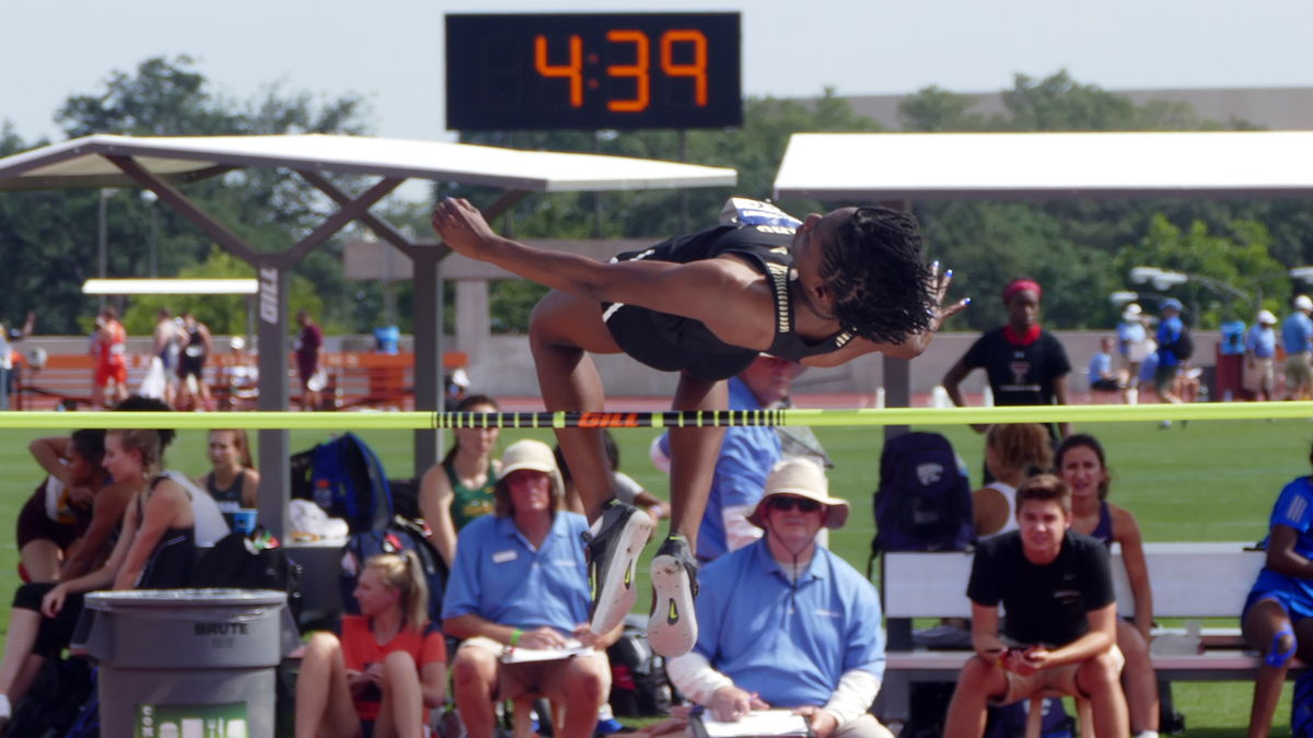 Rechelle competes in a high jump event.