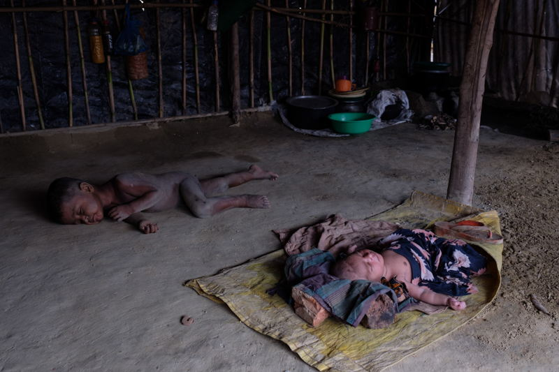 Children sleeping under a tent inside the camp. Photographer: Antonio Faccilongo