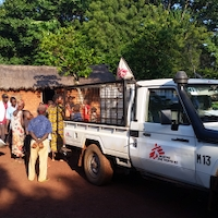 MSF staff distributing water to people who've been internally displaced by fighting in Zemio, CAR. They were among 7,000 people who have sought shelter at the local hospital. <br/>Just weeks after this photo was taken, On Tuesday 11 July, two armed men arrived at Zemio hospital in the southeastern region of CAR.<br/>The men threatened a family, one member of which had been a patient two weeks earlier but had been unable to leave the premises due to ongoing violence. As three members of the family – including a woman holding her baby – attempted to seek cover, the armed men shot at them, striking the child in the head and killing her instantly. A month later, another armed group opened fire in the hospital. Thousand fled into the surrounding bush and across the border to DRC. The site now sits vacant and MSF has ceased its operations in the area, with no patients to treat and the safety situation for our staff remaining precarious. Photographer: Josh Rosenstein