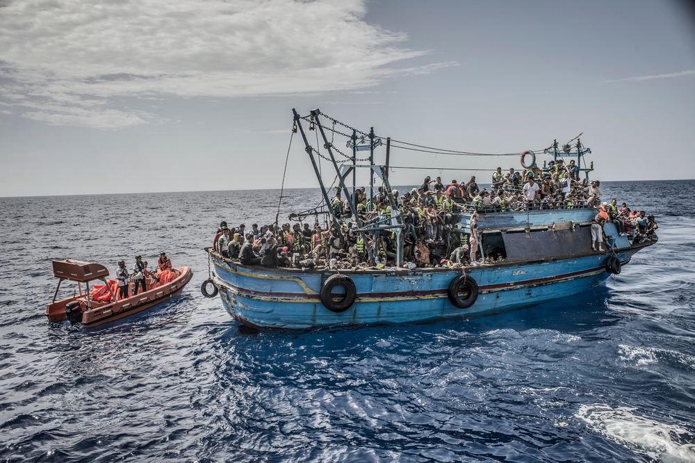 Photographer: Francesco Zizola<br/><br/>Caption: 26th August 2015. A boat containing approximately 650 people is rescued in the Mediterranean Sea by the Bourbon Argos and taken to Sicily, Italy.