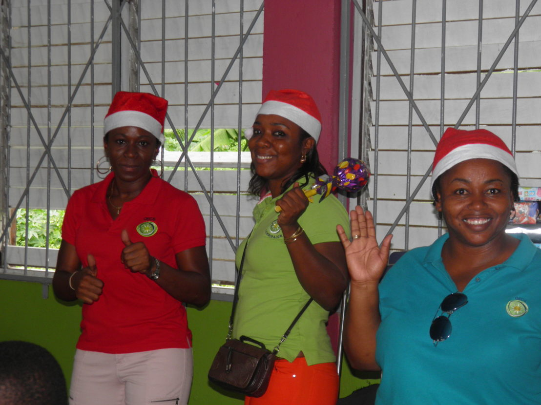 OECS Staff distributing gifts during the Toy Drive to Dominica.