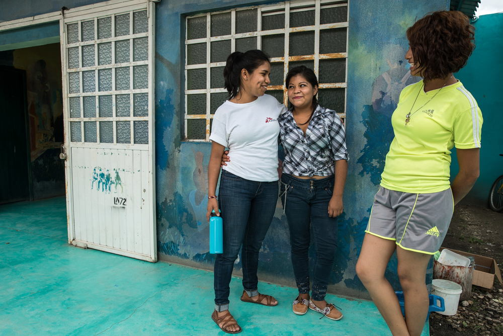 MSF psychologist Nadia Rivera, with two of her young patients, both survivors of sexual violence in Honduras. Photographer: Marta Soszynska