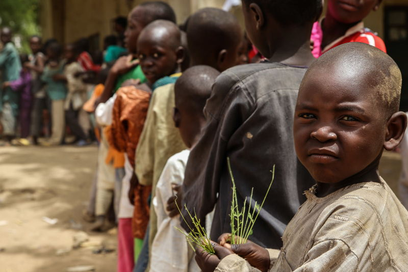 A child waits in the queue for a meningitis vaccination in Damaturu town, in the north-eastern Nigerian state of Yobe. Photographer: Igor Barbero/MSF