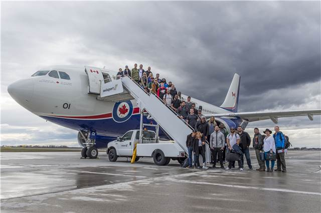 Brigadier-General Paul Rutherford along with Team Canada spring tour 2017 represented by Canadian Football League players, The Dallas Smith Band and stand-up comedian, John Sheehan get ready to board a flight in Ottawa, Ontario, to visit Operation UNIFIER and Operation REASSURANCE troops overseas on April 21, 2017.<br/><br/>Photo:  MCpl Mathieu Gaudreault, Canadian Forces Combat Camera