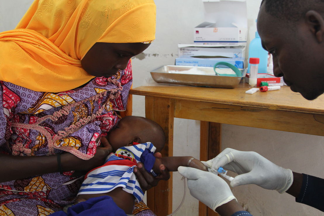 Eight-week-old Mohamed Zakari receives his first dose of the oral rotavirus vaccine (or the placebo). Eight weeks is the cut-off age.