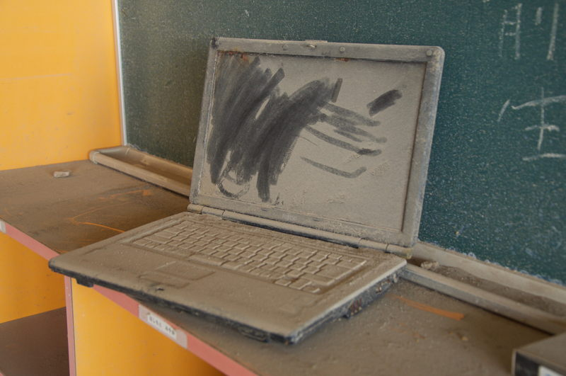 Laptop at abandoned school