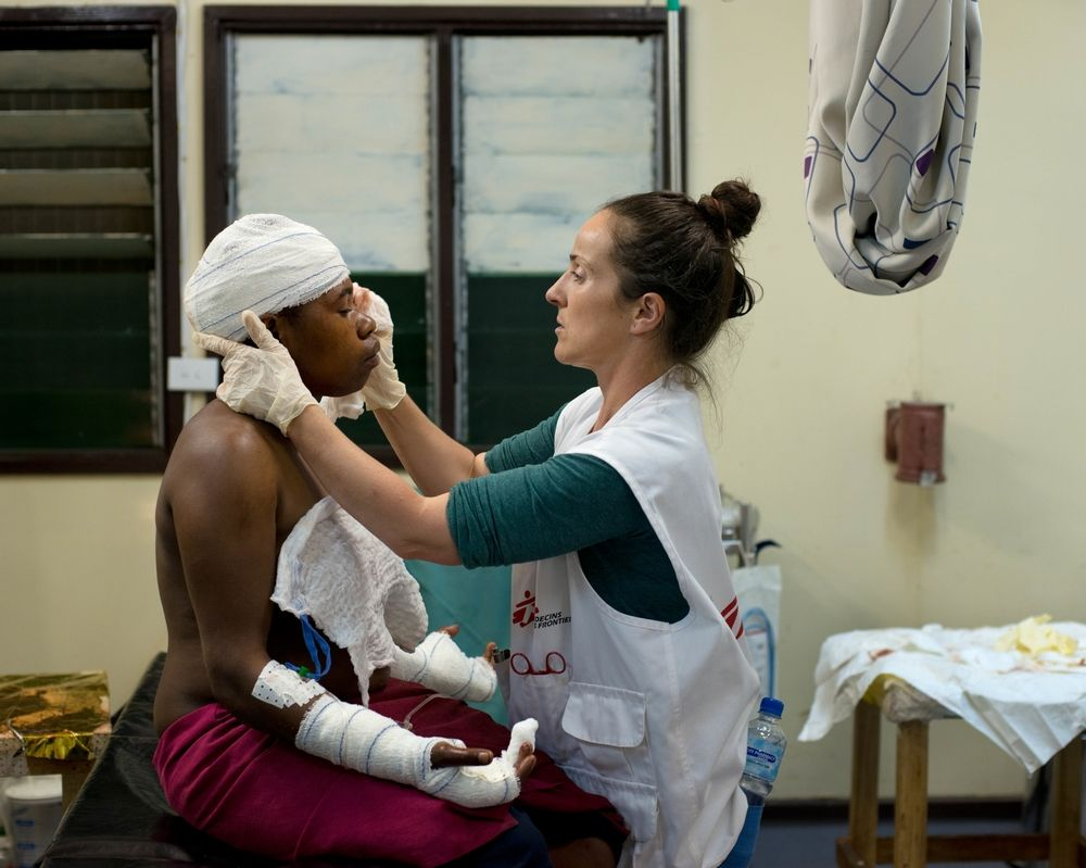 A woman receives medical care at MSF's family and sexual violence clinic in Tari hospital, Hela province, in the highlands region of Papua New Guinea. She sought treatment for lacerations after her husband cut her with a knife on the back of her head and both hands. Photographers: Jodi Bieber