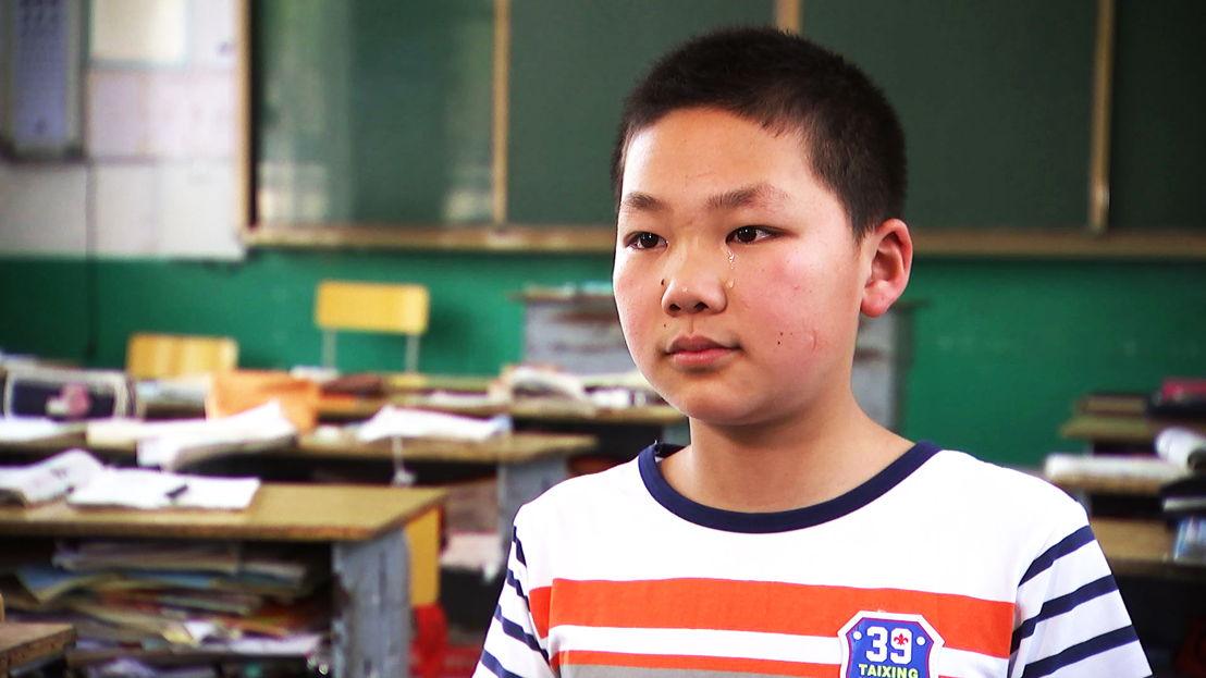 Missing his parents - Li Yikui, 13