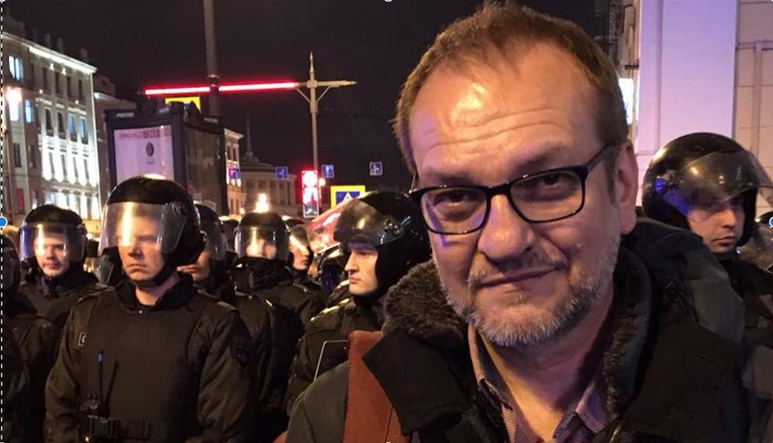 Reporter Eric Campbell. Riot police await demonstrators on Vladimir Putin's birthday