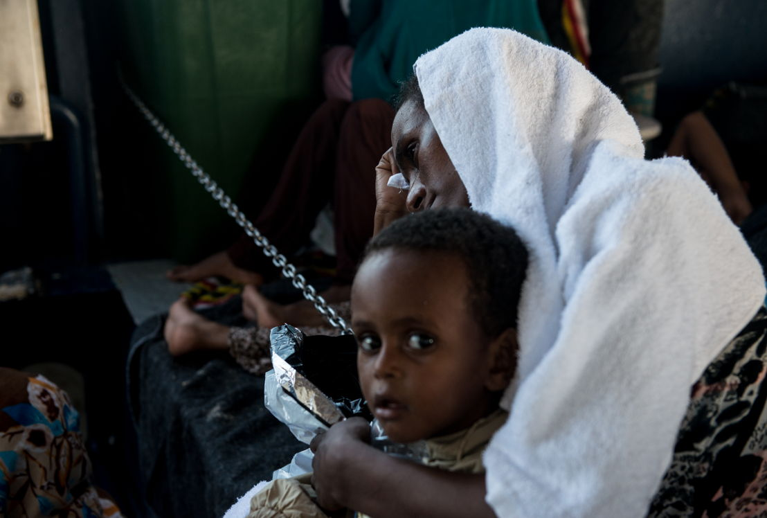 Credit: Gabriele François Casini / MSF<br/>Caption: Phoenix rescue 02 Sept 2015. A woman from Eritrea cries while holding her baby on the Phoenix's lower deck. The journey people go through both on land and at sea is extremely traumatizing.