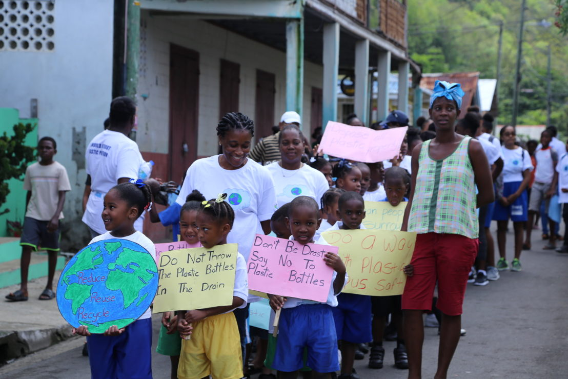 Students marching in the streets of Anse-La-Raye before the start of the clean up activity