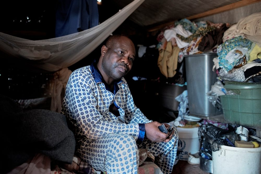 MSF159881<br/>Portrait of Valentin, at a displaced persons camp in M&#039;Poko, Bangui.<br/><br/>&quot;There are twelve people in this shelter. In the evening, we put a mattress on the floor and sleep next to each other. It&#039;s cold at night but fortunately an NGO gave us blankets a few days ago.&quot;<br/><br/>Valentin is a civil administrator. He lives in Mpoko camp near the airport in Bangui but is originally from PK5 district of Bangui. He fled his neighbourhood on December 5 following an outbreak of violence. Armed men came and killed two of his neighbours and one of his sons (Arthur, 38), and then they looted the house. Valentin had to bury his son in the plot of land that he owns because it was too dangerous to go to the cemetery. He then fled his neighbourhood to go to Mpoko camp. It took several days before he could meet his family again, as they had all been hiding in different places. With his wife, nine children (the youngest is 4 years old and the oldest 24 years old) and six grandchildren, they all slept outside in the camp when they first arrived: &quot;It was raining and we had to sleep outside. <br/><br/>With the salary of Valentin, the children can go to school and university and the family can live a better life than some other families in the camp, but that is still not enough to feed everyone. &quot;After the Pope&#039;s visit, it felt like there was a wave of solidarity amongst the population but is that enough to maintain security?&quot; Valentin wants the rapid disarmament of armed groups that are, according to him, the origin of the trouble in the country. &quot;The presidential elections offer hope. We hope whoever is elected will be respected by all. &quot;
