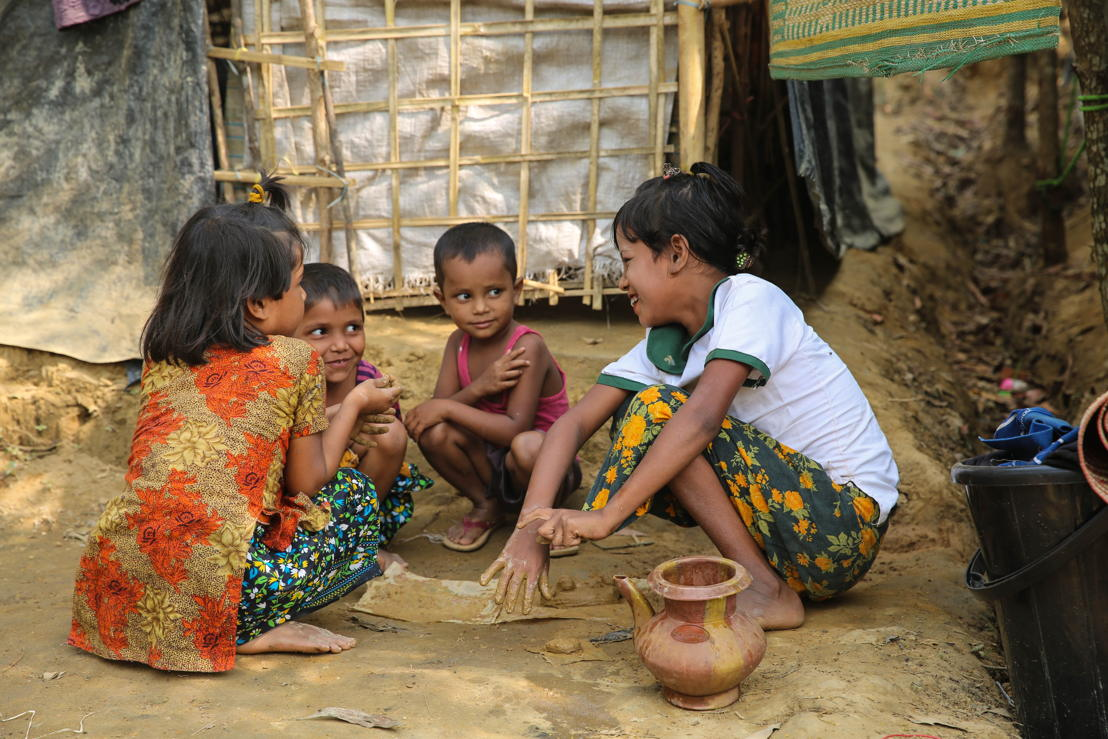 Children at a camp for Rohingya refugees in Bangladesh play in the mud. Conditions are dismal here, and disease spreads extremely quickly, in part because the soil is contaminated with human faeces. Photographer: Mohammad Ghannam