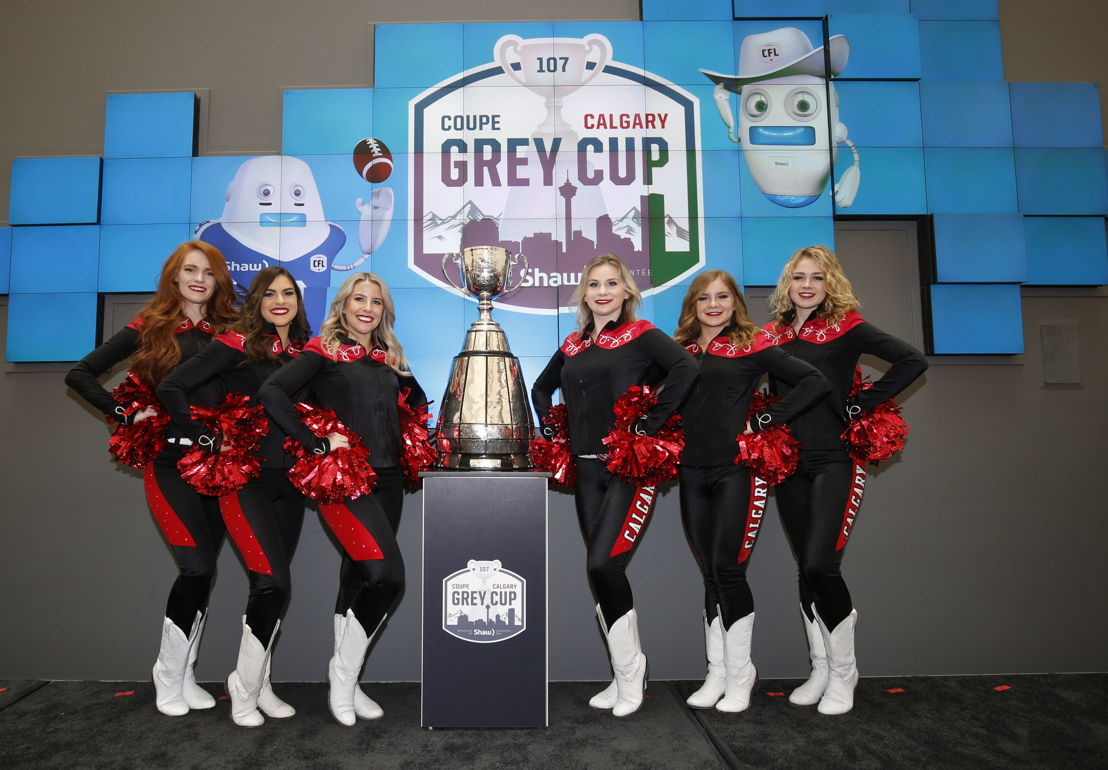 The Outriders pose with the Grey Cup. Photo Credit: Todd Korol