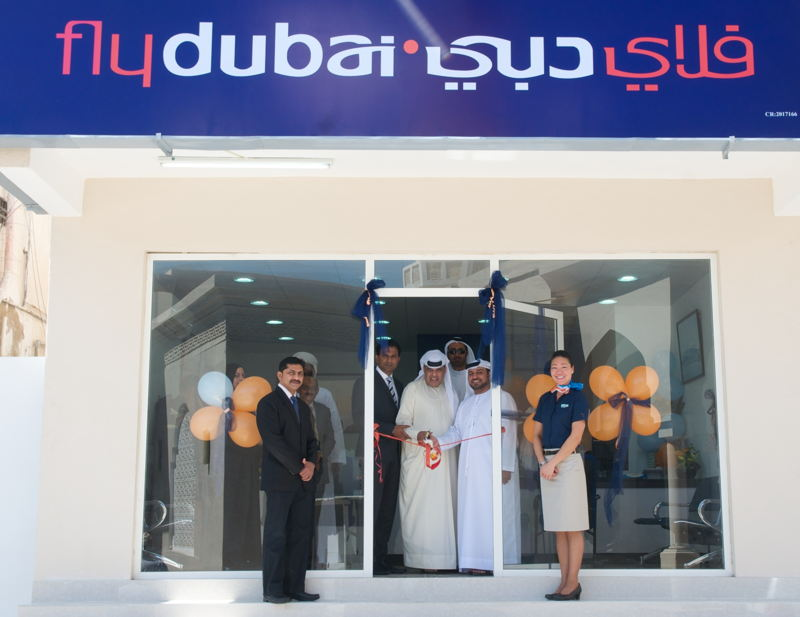Sudhir Sreedharan, flydubai's Head – Commercial Operations Subcontinent, GCC and Africa, Hamad Obaidalla and Mohamed Al Zarouni open the flydubai Travel Shop in Salalah