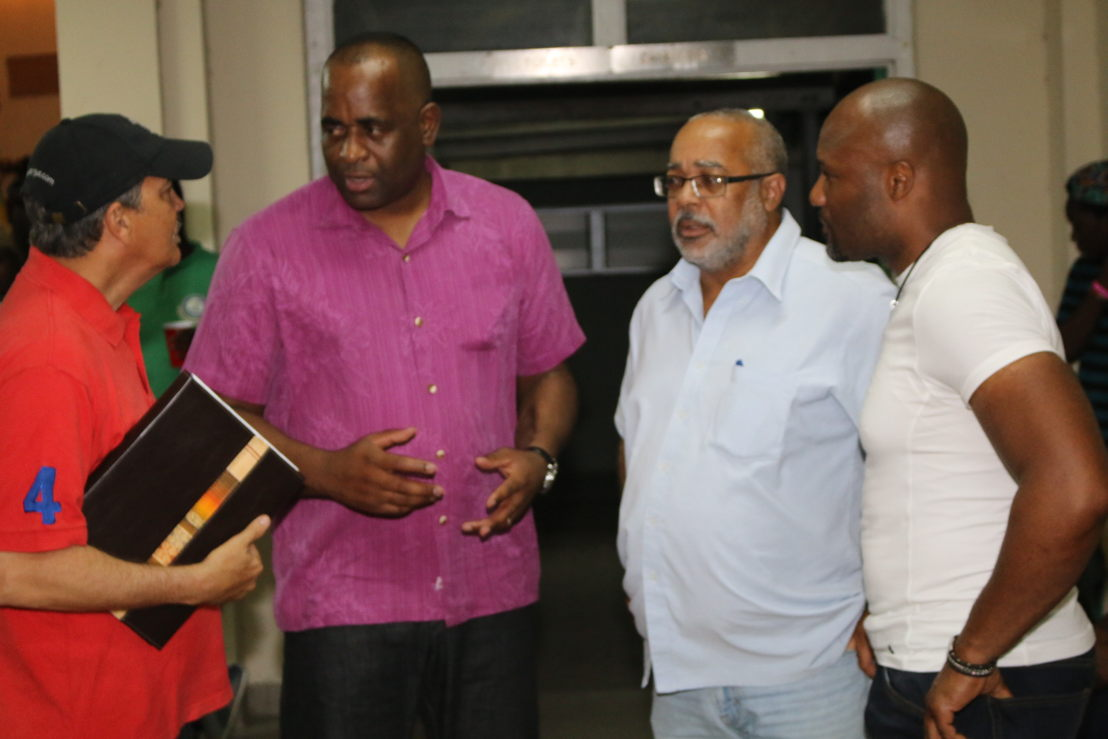Prime Minister Skerrit and Dr. Didacus Jules meet with disaster management officials.