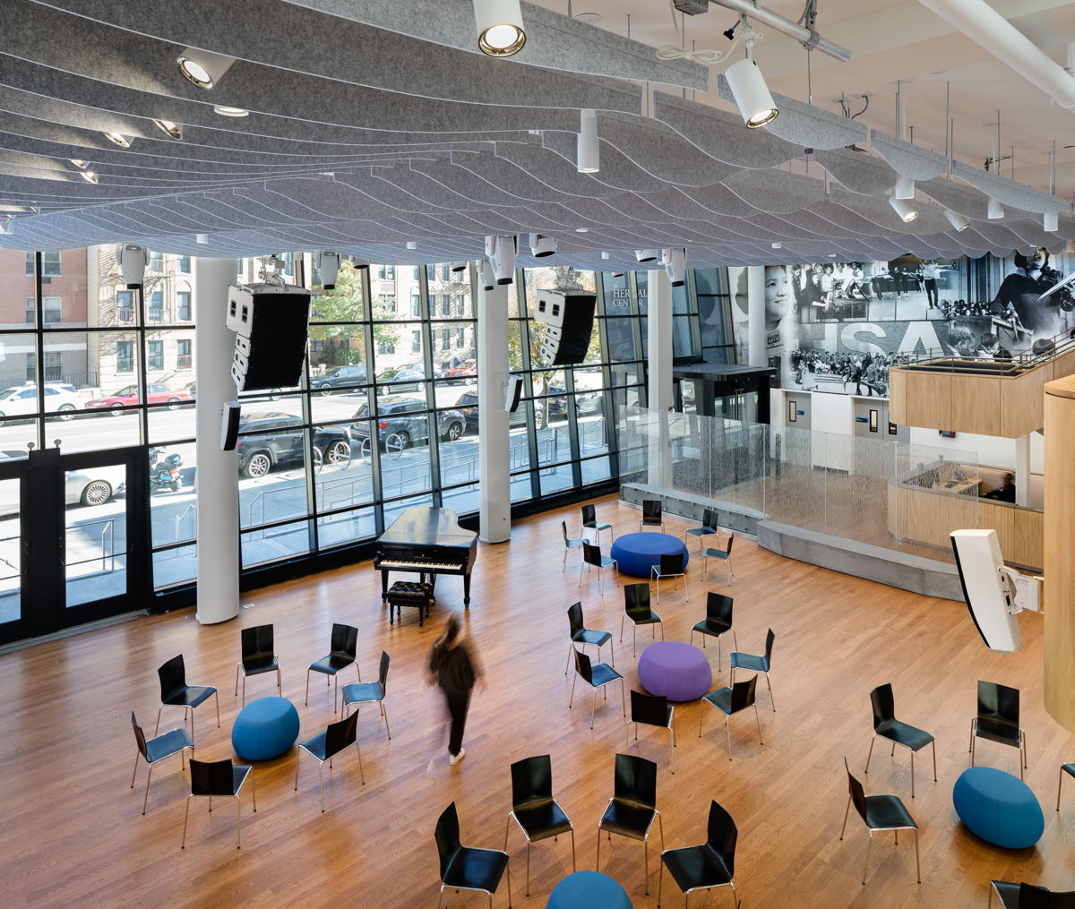 In order to guarantee optimal acoustics in the space, the design team recommended a precise angling of the towering two-story glass wall, an approach that had been successfully engaged by the firm for the Appel Roomat Jazz at Lincoln Center.  - Photo by Amy Barkow
