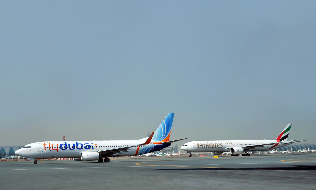 An Emirates and a flydubai aircraft at Dubai International Airport.