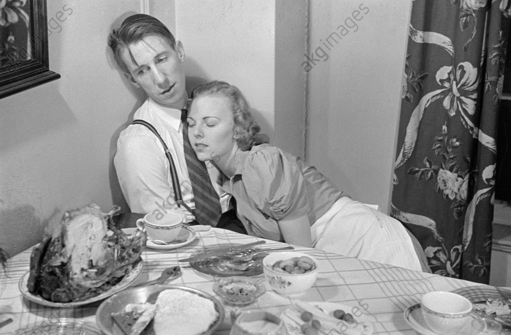 Young couple relaxing after Thanksgiving dinner (George Mann and Barbara Bradford Mann).<br/>Photo, New York, 1938<br/>AKG1013862