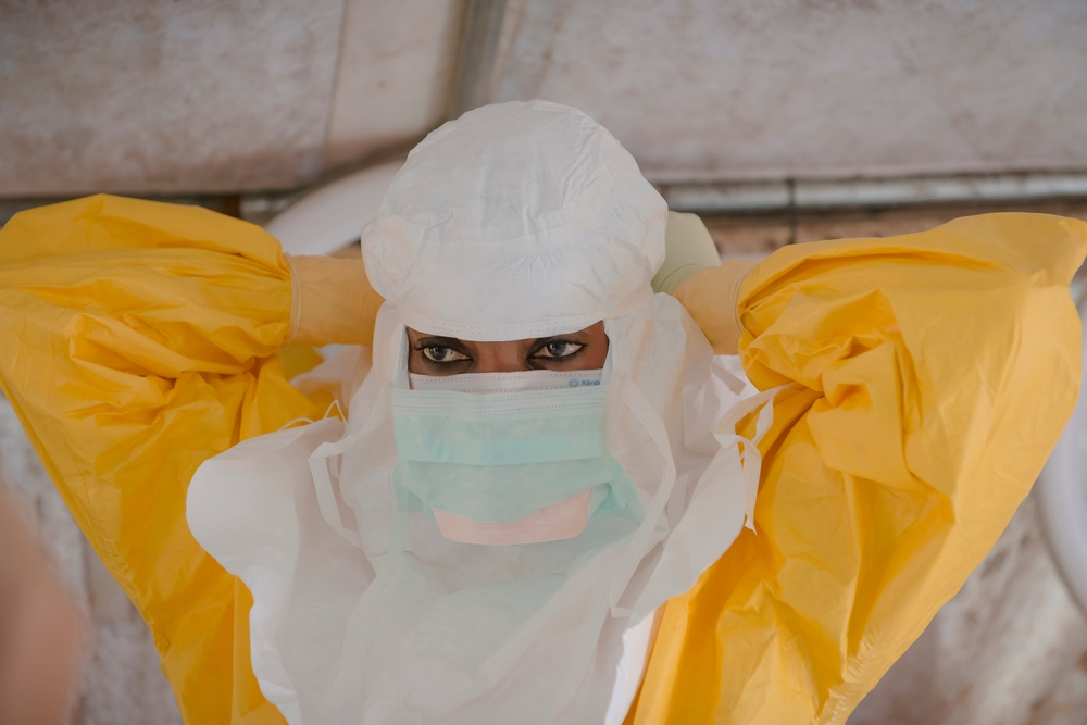 System identifier: MSB17721<br/>Title:<br/>Photographer / cameraman: Yann Libessart<br/>Countries: Guinea<br/>Description: MSF staff dressing in PPE to enter the high risk zone at MSF ETC in Donka, Conakry.