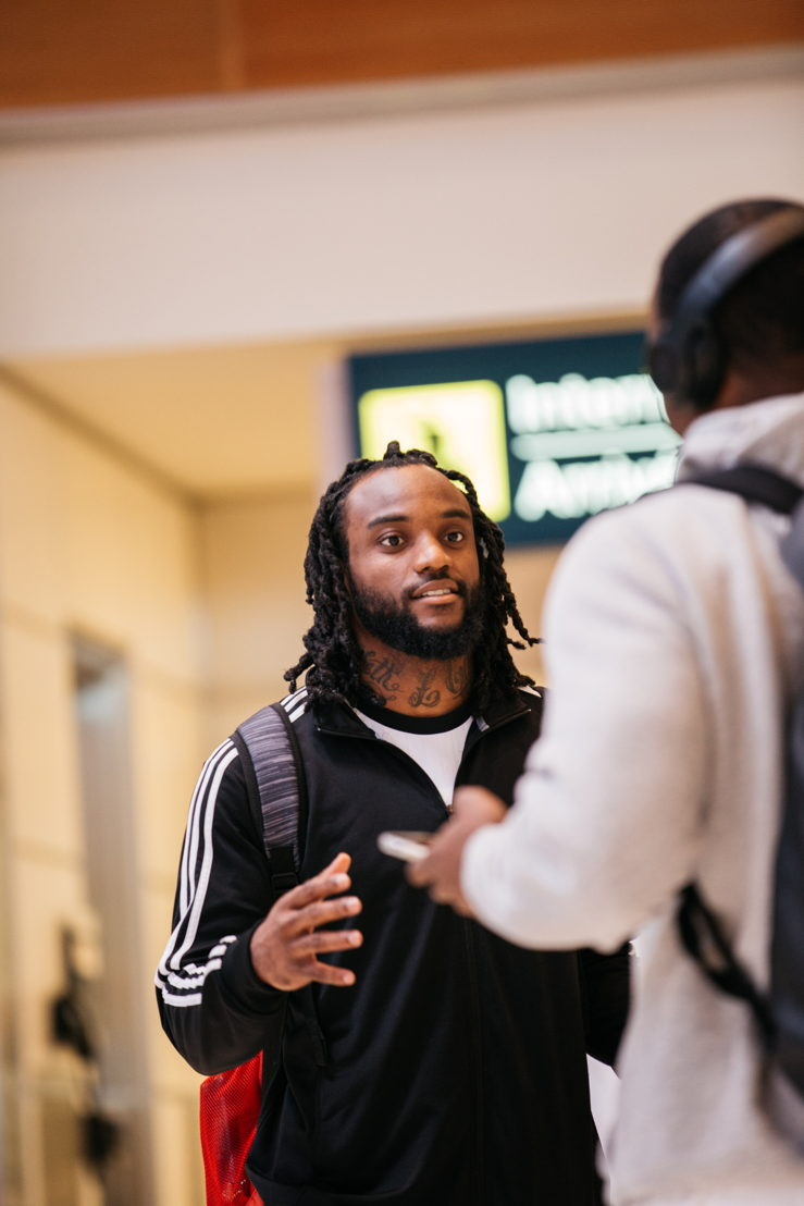 Odell Willis greets Ed Gainey as he arrives in Winnipeg for Mark's CFL Week. Photo credit: CFL.ca/Reid Valmestad