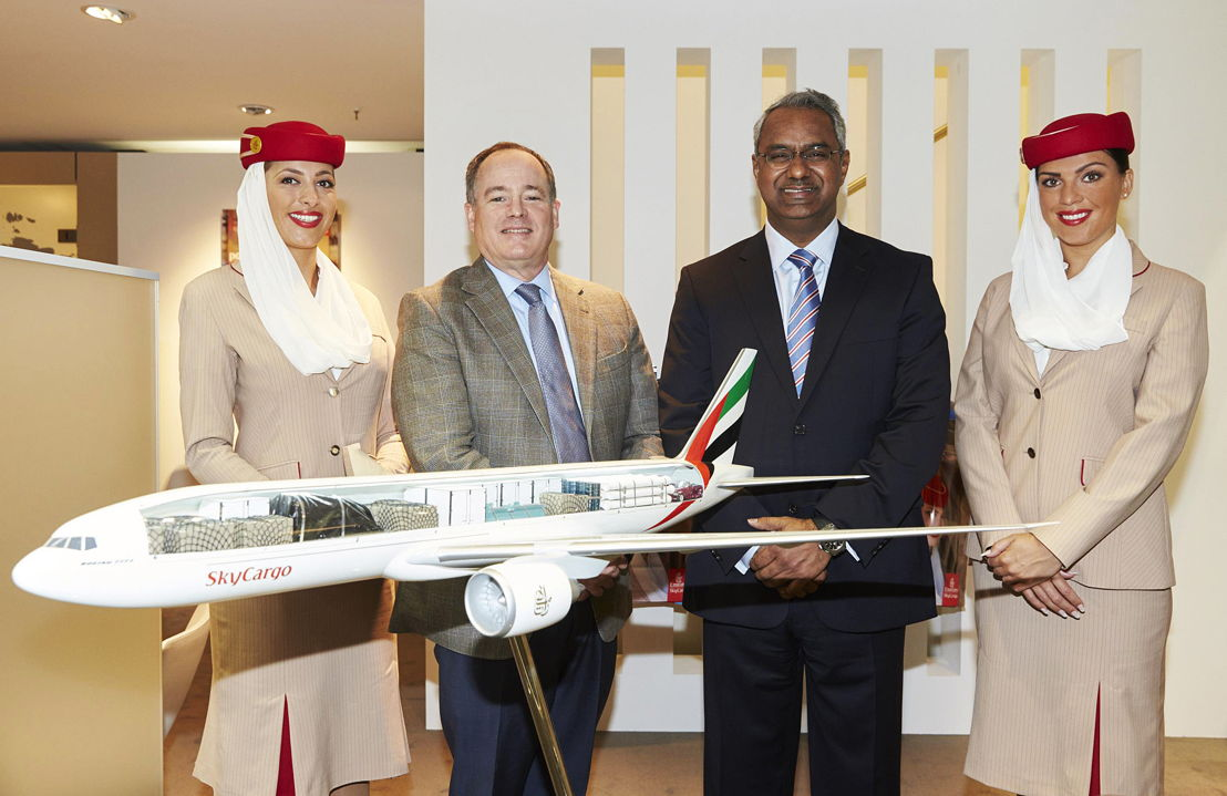 David Whitaker (left), Vice President Business Development &amp; Communications, Rickenbacker International Airport, and Nabil Sultan, Emirates Divisional Senior Vice President, Cargo, <br/>flanked by Emirates Cabin Crew, at the Air Cargo Europe Exhibition and Conference in Munich.