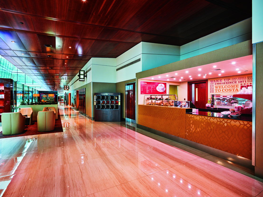 Customers passing through the Emirates Business Class lounge in need of a caffeine fix can enjoy freshly- brewed beverages prepared by Costa Coffee baristas<br/>Intro &amp; Contact us<br/>Images<br/>Conversations<br/>Emirates Media Centre Logo Go to Homepage.<br/>Emirates.com<br/>Inflight advertising<br/>Sponsorship requests<br/>International &amp; Government Affairs<br/>See Press Contact Information<br/>Search other stories<br/>Media centre<br/>A380<br/>Boeing 777<br/>Corporate News<br/>Emirates Sponsorships<br/>Network<br/>The Emirates Experience<br/>Media Gallery<br/>Emirates completes US$11 million makeover of its Business Class lounge at Dubai International Airport<br/>Enhances lounge offering with exclusive partnerships with Moët &amp; Chandon, Voss Water and Costa Coffee<br/>Dubai, UAE, 23 October 2016 – Emirates has completed a major makeover of its Business Class lounge at Concourse B of Dubai International Airport. The US$11 million refurbishment project took two years to complete and is part of the airline's continuous investment to improve and upgrade its products for a seamless and enjoyable travel experience.<br/><br/>Emirates' premium customers can now look forward to an enhanced lounge experience with three new distinct concept areas within the Emirates Business Class Lounge. The latest food and beverage concepts cater to diverse tastes and include a barista experience in partnership with Costa Coffee, a Health hub with Voss water featuring healthier options, and an exclusive Moët &amp; Chandon champagne lounge.<br/><br/>The new offering is in addition to the seven other locations within the lounge with gourmet cuisine prepared by on-site chefs and a complimentary full bar service, which includes premium wine, spirits and champagne.<br/><br/>All the food and beverages offered within the lounge are complimentary for Emirates First Class and Business Class customers, as well as Emirates Skywards Platinum, Gold and Silver members - the airline's frequent flyer programme.<br/><br/>Barista experience<br/><br/>Customers passing through the Emirates Business Class lounge in need of a caffeine fix can enjoy complimentary handcrafted beverages prepared by Costa Coffee baristas as well as a fresh range of pastries, provided round the clock. The coffee bar will serve signature Costa drinks made using their unique Mocha Italia espresso blend.<br/><br/>Beverages available include their signature Flat White along with iced coffees and favourites like cappuccinos and caffe lattes.<br/><br/>Health hub<br/><br/>For the health conscious traveller, Emirates has introduced the Health hub in partnership with Voss water. With an increasing demand for health, well-being and more nutritious meals, Emirates is the first airline to have a dedicated health hub within its lounge.<br/><br/>The new station allows travellers to rehydrate and recharge before their flights with a selection of fruit and water infusions. It also features a healthy menu of gourmet sandwiches, wraps, and salads. Healthier beverages such as a selection of juices and smoothies are also available.<br/><br/>Champagne lounge<br/><br/>Customers looking to unwind before their flight can look forward to the Moët &amp; Chandon champagne lounge created exclusively for Emirates. The first-of-its-kind lounge to be located in an airport reinforces Emirates and Moët Hennessy's longstanding partnership of over 25 Years.<br/><br/>Moët Hennessy champagnes are a mainstay of the Emirates experience; however, this is the first time an airline is serving four of Moët &amp; Chandon&#039;s finest champagnes in one place. This includes Moët Impérial, Moët Rosé Impérial, Moët &amp; Chandon Grand Vintage and Moët Nectar Impérial.<br/><br/>To complement each champagne, chefs from Emirates flight catering and the in-house lounge teams collaborated with Moët &amp; Chandon, to create a unique selection of canapés - from sweet to savoury flavours. The canapé menus are changed monthly and include selections such as smoked salmon wrapped in nori with wasabi mayonnaise to complement the Moët &amp; Chandon Grand Vintage 2006 and passion fruit and jasmine tea macaroons to be paired with Moët Nectar Impérial.<br/><br/>Guests can enjoy their drinks at the chic bar featuring a golden wave design adorned with 2,400 intricate gold leaves applied individually by hand.<br/><br/>The three new refreshment areas are the first of a several new concepts planned for the lounges at the Emirates hub in Dubai. In the coming year, Emirates is looking to further improve the customer experience by introducing a sports bar and a cocktail bar within its lounges.<br/><br/>The Business Class lounge in concourse B is one of six Emirates lounges at Dubai International Airport and is part of a network of 39 dedicated airport lounges located within major airports around the globe. Each lounge has been designed with the same attention to detail and exceptional service offering premium customers the highest standards of comfort and ease at every stage of their journey.<br/><br/>The newly refurbished lounge measures close to 10,000 square feet to accommodate over 1,500 customers – a 40% increase in seating capacity. In addition to the new refreshment stations, the children's play area with arcade quality games has been doubled in size, and the Timeless Spa within its premise has been renovated and offers hair, beauty and therapy treatments.<br/><br/>Lounge guests can also refresh with a shower, unwind at designated quiet areas, stay up to date with the latest news and live sports and stay connected with complimentary Wi-Fi.<br/><br/>-end-<br/><br/>Moët &amp; Chandon champagne lounge canapés include:<br/><br/>Veal bacon gougere  <br/>Pea and mint soup<br/>Cold lentils soup<br/>Goat cheese and Emmental gougere<br/>Smoked salmon wrapped in Nori, wasabi mayonnaise<br/>Lime and avocado soup<br/>Pear &amp; blue cheese crostini, caramelized walnut<br/>Sliced smoked duck on sushi rice &amp; hoisin sauce<br/>Asparagus &amp; leeks tartelette<br/>Cauliflower Pannacotta and teriyaki sauce<br/>Beef bresaola honey roast fig &amp; pumpernickel bread<br/>Chicken with spice tomato and mango<br/>Manna Talib<br/>Emirates Public Relations<br/><br/>Emirates Group<br/><br/>About Emirates<br/>Our Media centre contains all of our business updates, including the latest press releases and articles and our contact details.<br/><br/>The Emirates story started in 1985 when we launched operations with just two aircraft. Today, we fly the world's biggest fleets of Airbus A380s and Boeing 777s, offering our customers the comforts of the latest and most efficient wide-body aircraft in the skies.<br/><br/>We inspire travellers around the world with our growing network of destinations, industry leading inflight entertainment, regionally inspired cuisine and world-class service.