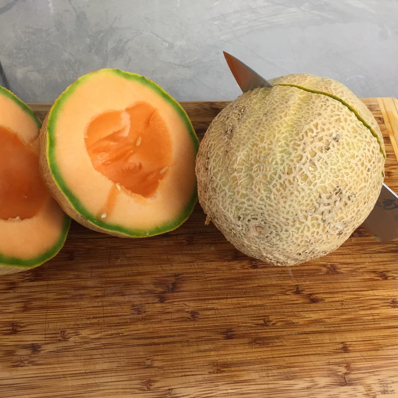 Slicing organic Hirakata Farms cantaloupe before adding it to the wort