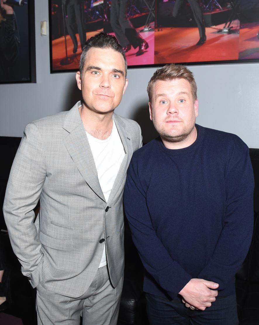 Robbie Williams y James Corden