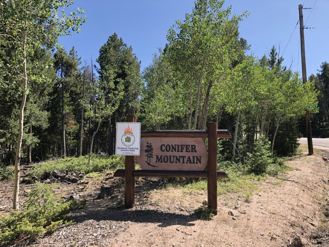 As fire season ignites, Conifer Mountain Homeowners Association community is certified as a Firewise USA® Community