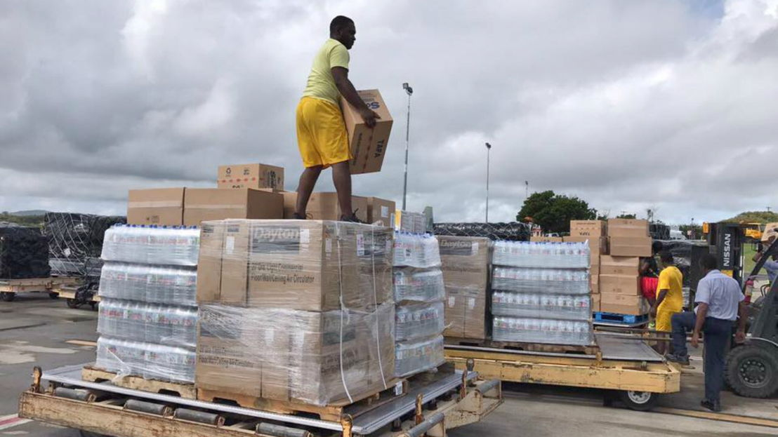 Receipt and distribution of relief items (Photo courtesy ABS TV)