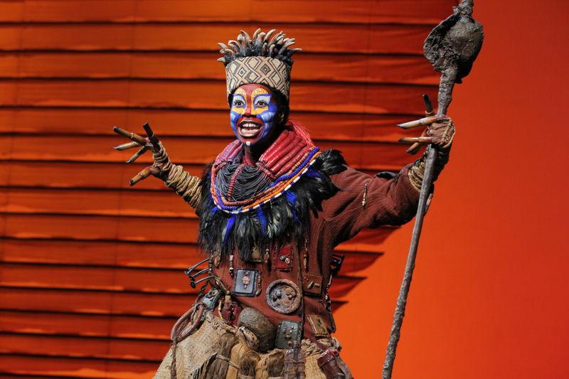 "Buyi Zama as ""Rafiki"" in THE LION KING North American Tour.  ©Disney.  Photo by Joan Marcus."