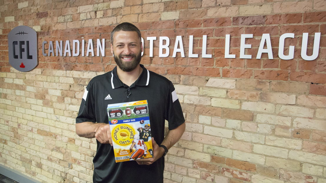 Mike Reilly with his Collector's Edition Post CFL cereal box