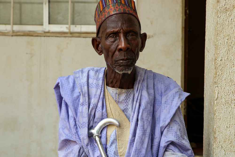 """Baba Makintu, community elder from Damaturu town (Yobe state, northern Nigeria), 92 years old. """"When I was younger, at around 25 years of age, I got meningitis. It affected my vision. For a while I couldn't see anymore. It also deformed one of my legs. It is now very weak. This disease has hit many of my family members in Damaturu. I have seen people die because of it, creating havoc in many families. This is why I think it is so important to get vaccinated. We encourage everyone to carry out such interventions."""" Photographer: Igor Barbero/MSF"""
