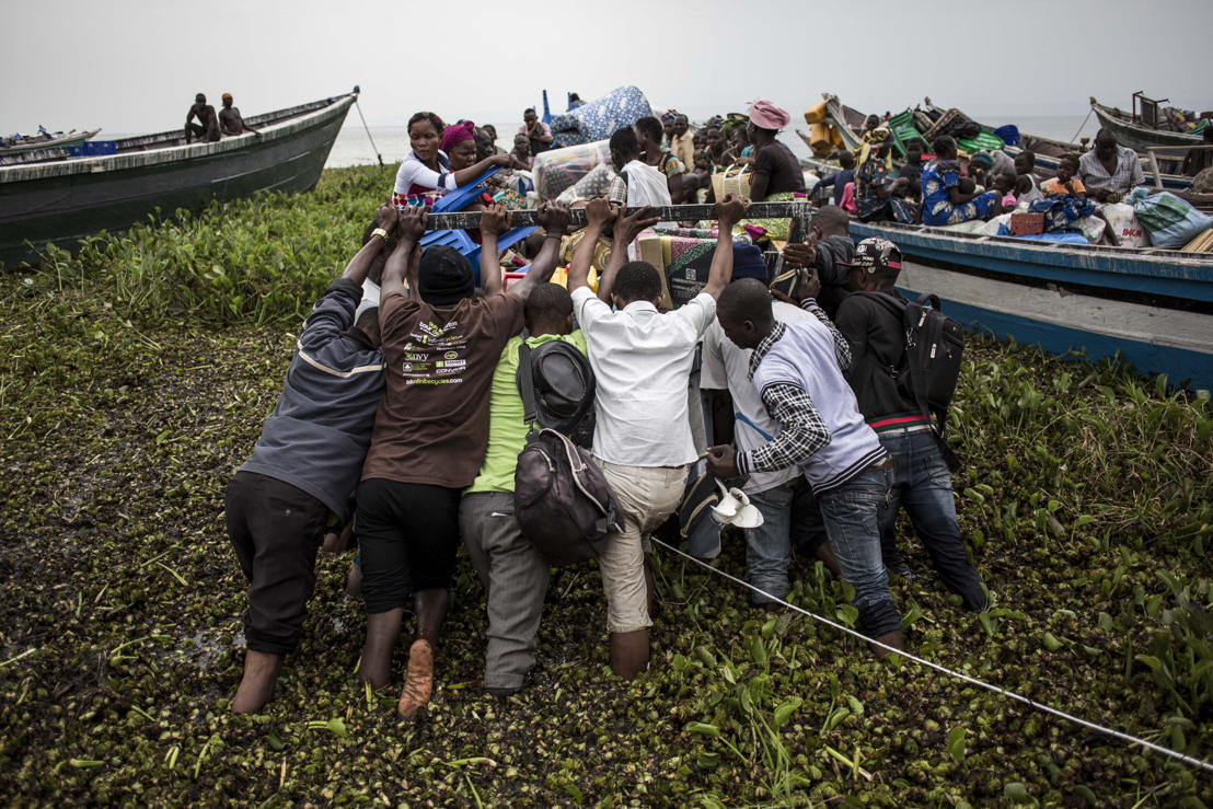 On 5 March 2018, internally displaced Congolese push a boat into Lake Albert. It will will take them to the relative safety of Uganda. The town of Tchomia is the one of the main towns for thousands of Congolese IDPs to flee to refugee camps on the shores of Lake Albert in Uganda. After the cholera outbreak in the refugee camps in Uganda, there is a fear of a subsequent outbreak in Tchomia, which would affect thousands of IDPs taking refuge along the shoreline of Lake Albert in DRC. PHOTO/JOHN WESSELS