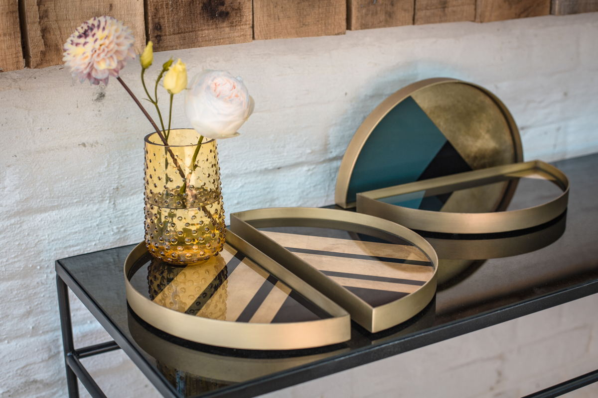 Notre Monde heavy aged mirror console and half-moon mini trays.