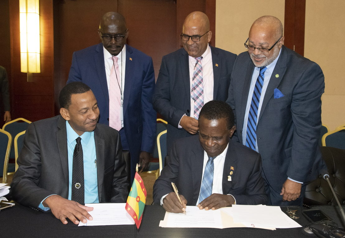Prime Minister of Grenada, Dr. the Rt. Hon. Keith Mitchell and Managing Director (Ag) of ECTEL, Mr. Andrew Millett, sign Protocol Amending the Treaty Establishing the Eastern Caribbean Telecommunications Authority.