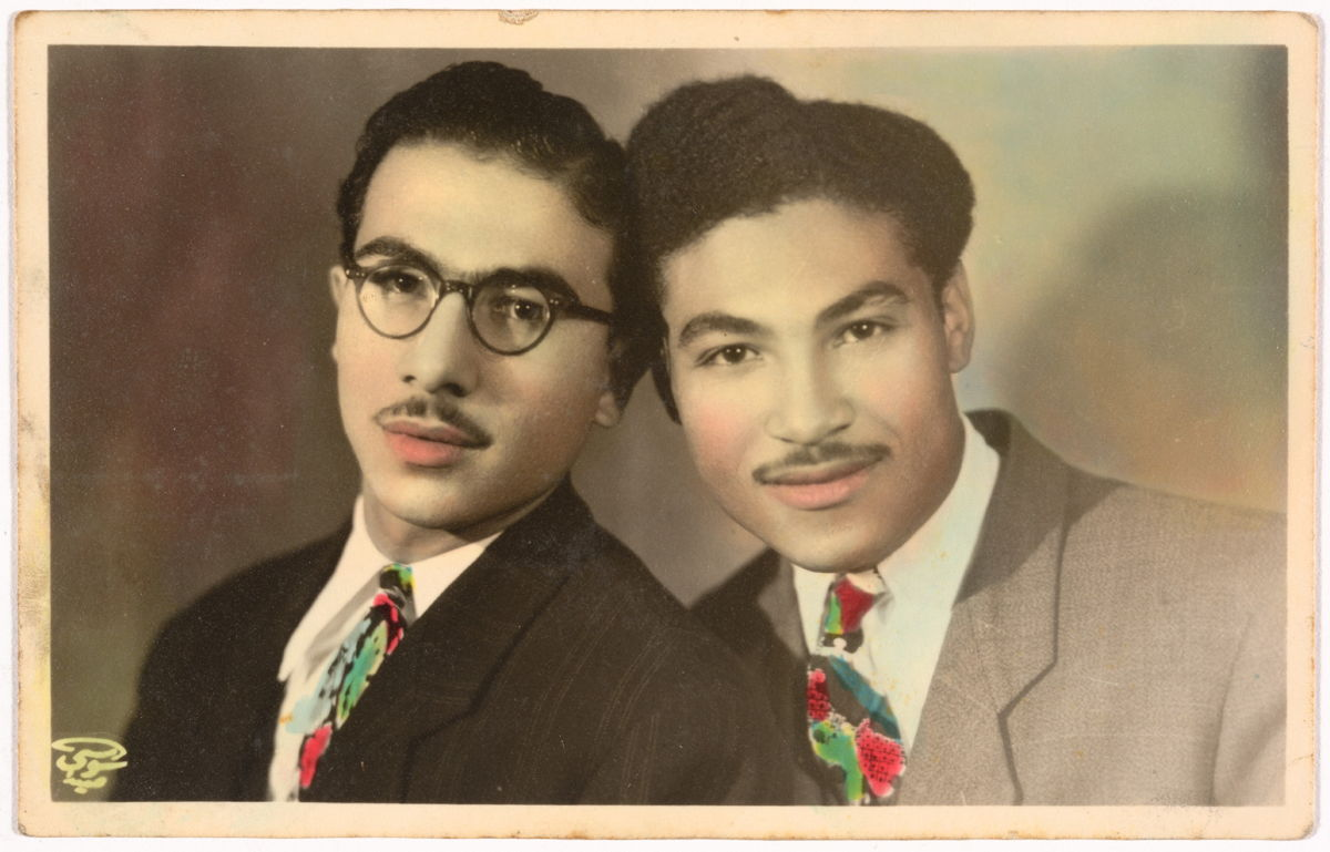 Hand-coloured portrait of Hussein and Ahmed Assad by Anis el Soussi in Lebanon, January 1, 1946, gelatin silver developing-out paper print. Fahime Zeidan Collection, courtesy of the Arab Image Foundation