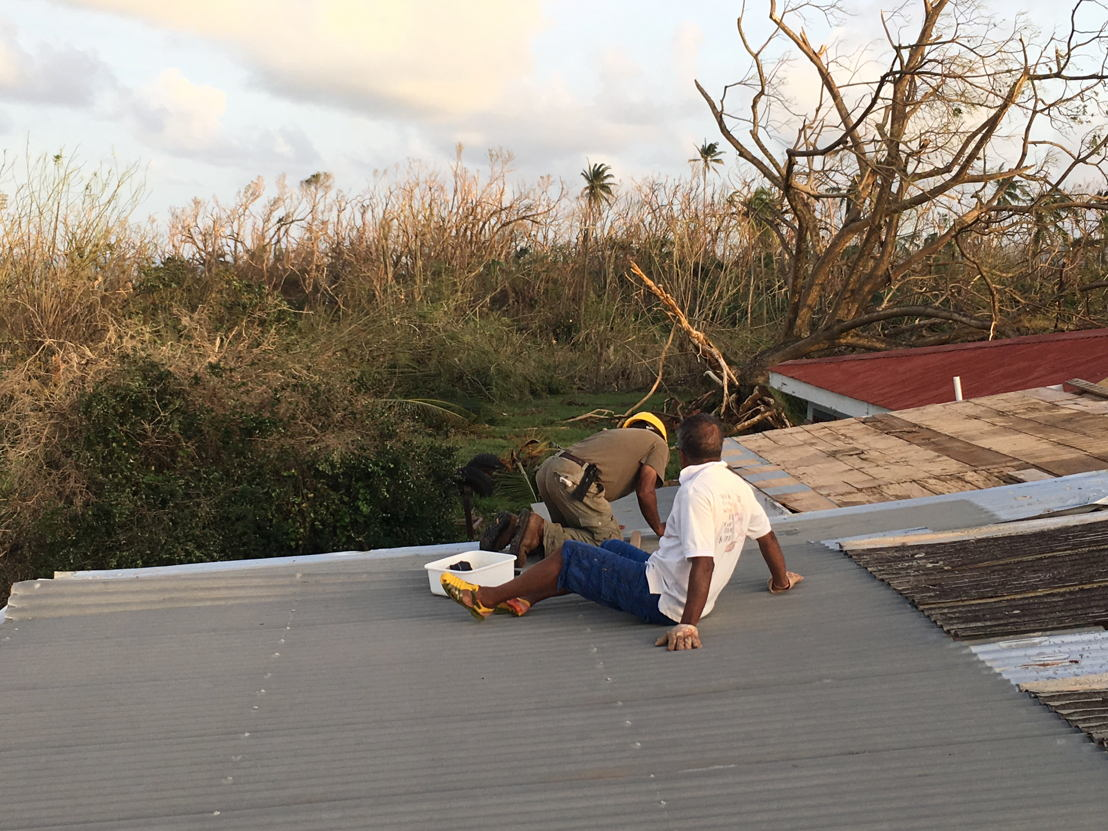 roof repair after the passage of hurricane Maria in Dominica