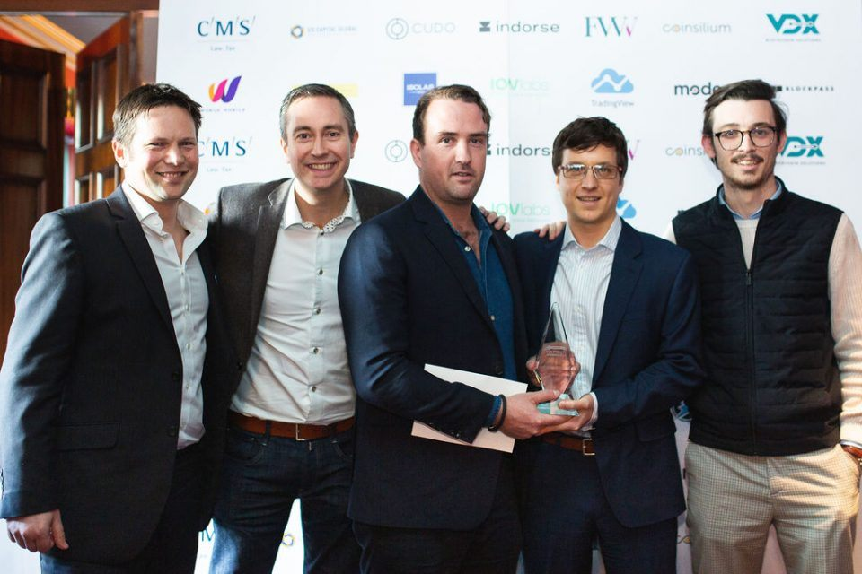 Richard Ells delivered the first (Community Enghancement) award to the CryptoCompare team.